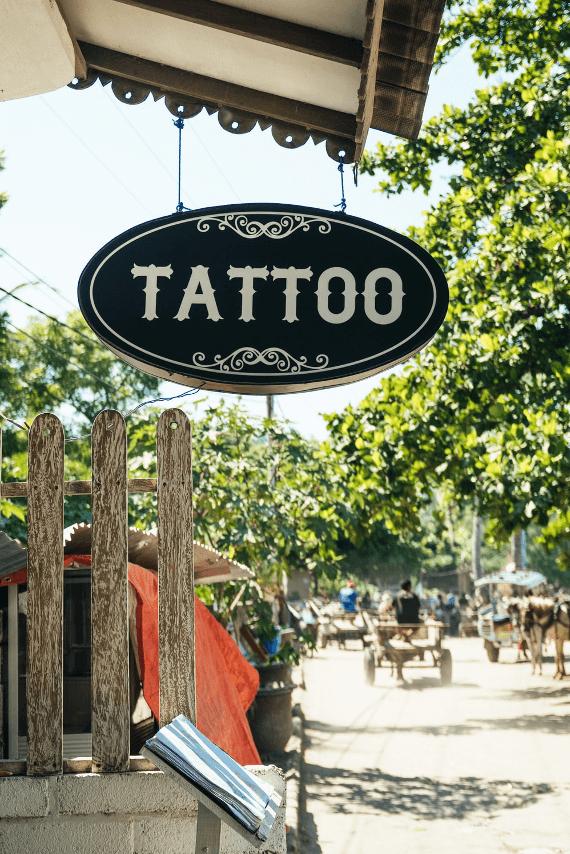 black and white Tattoo-printed signage
